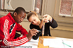 Education High School science lab physics male and female student working together