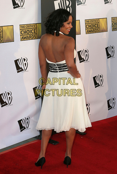 SANAA LATHAN.11th Annual Critics' Choice Awards - Arrivals held at Santa Monica Civic Auditorium, Santa Monica, California..January 9th, 2006.Photo: Zach Lipp/AdMedia/Capital Pictures.Ref: ZL/ADM.full length looking over shoulder white dress.www.capitalpictures.com.sales@capitalpictures.com.© Capital Pictures.