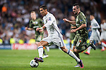 Cristiano Ronaldo (l) of Real Madrid runs past Michal Kucharczyk of Legia Warszawa during the 2016-17 UEFA Champions League match between Real Madrid and Legia Warszawa at the Santiago Bernabeu Stadium on 18 October 2016 in Madrid, Spain. Photo by Diego Gonzalez Souto / Power Sport Images