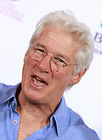 "L'attore statunitense Richard Gere posa durante un photocall per la presentazione del film ""Time Out of Mind"" al Festival Internazionale del Film di Roma, 19 ottobre 2014.<br /> U.S.actor Richard Gere poses for a photocall to present the movie ""Time Out of Mind"" during the international Rome Film Festival at Rome's Auditorium, 19 October 2014.<br /> UPDATE IMAGES PRESS/Isabella Bonotto"