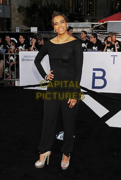 "Daphne Wayans.""Oblivion"" Los Angeles Premiere held at the Dolby Theatre, Hollywood, California, USA..April 10th, 2013.full length black top trousers see through thru nipples tape clutch bag.CAP/ROT/TM.©Tony Michaels/Roth Stock/Capital Pictures"