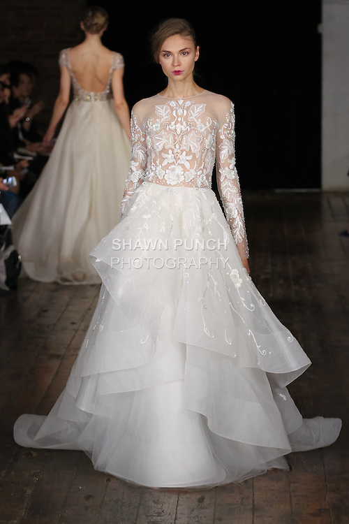 """Model walks runway in an """"Irresistable"""" bridal gown from the Rivini by Rita Vinieris Fall 2017 collection on October 7th, 2016 during New York Bridal Fashion Week."""