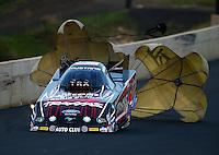 Jul. 18, 2014; Morrison, CO, USA; NHRA funny car driver Courtney Force during qualifying for the Mile High Nationals at Bandimere Speedway. Mandatory Credit: Mark J. Rebilas-