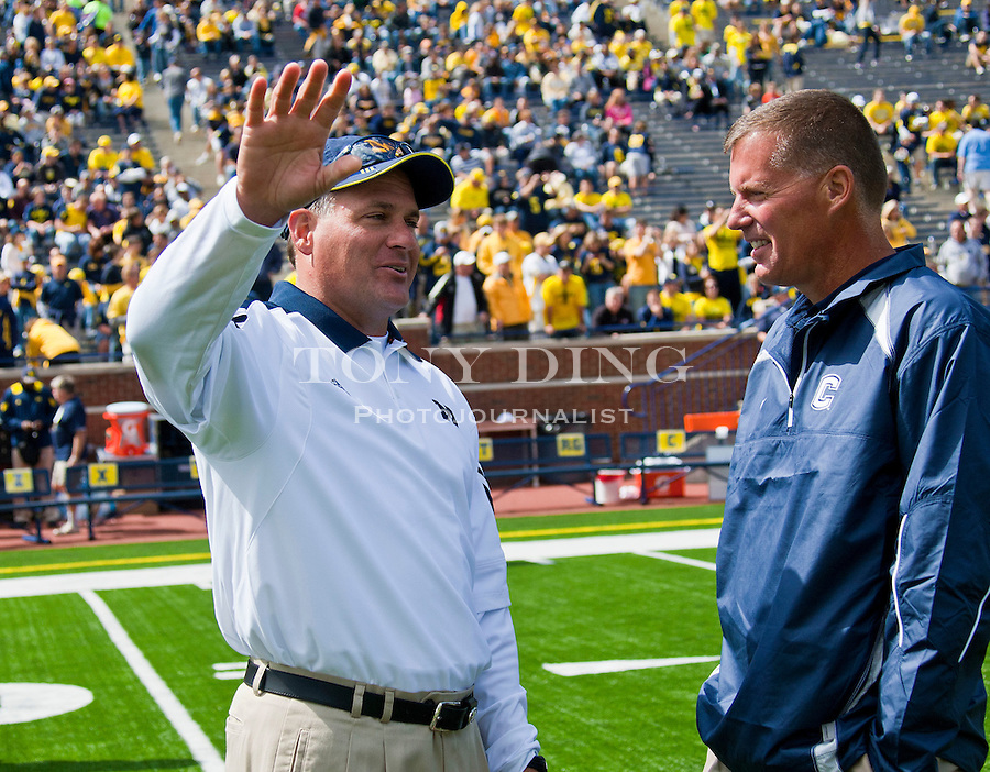 Michigan head coach Rich Rodriguez, left, talks with Connecticut head coach Randy Edsall before an NCAA college football game, Saturday, Sept. 4, 2010, in Ann Arbor, Mich. (AP Photo/Tony Ding)