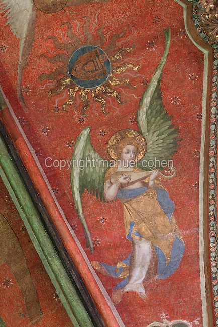 Fresco of an angel playing a mandore, a plucked stringed instrument with domed soundboard and carved head, with a plectrum, 1380, attributed to Jan de Bruges, on the vaulted ceiling of the Chapelle de la Vierge or Chapel of the Virgin, in the Cathedrale Saint-Julien du Mans or Cathedral of St Julian of Le Mans, Le Mans, Sarthe, Loire, France. The sun above the angel's head contains the image of Gontier Baigneux. The frescoes were restored in the late 20th century. The cathedral was built from the 6th to the 14th centuries, with both Romanesque and High Gothic elements. It is dedicated to St Julian of Le Mans, the city's first bishop, who established Christianity in the area in the 4th century AD. Picture by Manuel Cohen