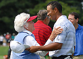 Bethesda, MD - July 4, 2007 -- Former first lady Barbara Bush greets Tiger Woods on the course during the inaugural Earl Woods Memorial Pro-Am Tournament, part of the AT&T National PGA Tour event, Wednesday, July 4, 2007, at the Congressional Country Club in Bethesda, Maryland.  The event was held in honor of soldiers and military families. .Credit: Molly A. Burgess - DoD via CNP    .