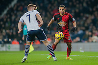 WEST BROMWICH, ENGLAND - FEBRUARY 11: Jefferson Montero of Swansea City  takes the ball past James Morrison of West Bromwich Albion    during the Premier League match between West Bromwich Albion and Swansea City at The Hawthorns on February 11, 2015 in West Bromwich, England. (Photo by Athena Pictures/Getty Images)
