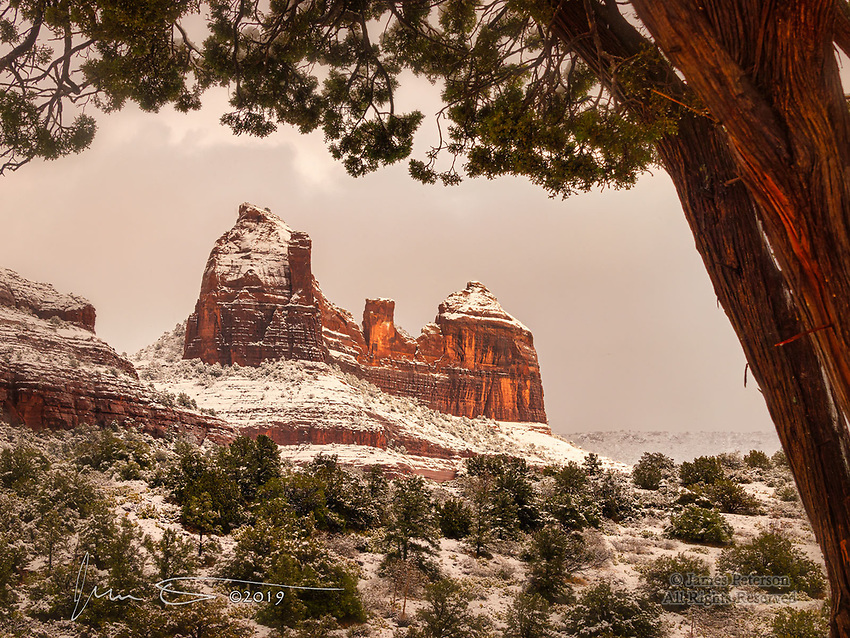 Winter at Mitten Ridge.  Looming above Bear Wallow Canyon and overlooking Sedona, Arizona, this sandstone monument in the Coconino National Forest loves to show off its winter finery.<br /> <br /> Image ©2019 James D. Peterson
