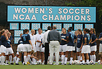 "24 September 2009: UNC head coach Anson Dorrance (in white) talks to his team before the game with their ""Women's Soccer NCAA Championship"" banners as a backdrop. The University of North Carolina Tar Heels defeated the Duke University Blue Devils 2-1 in sudden victory overtime at Fetzer Field in Chapel Hill, North Carolina in an NCAA Division I Women's college soccer game."