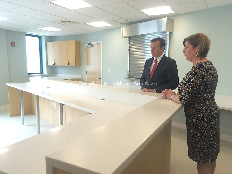 TORRINGTON, CT - 08 July 2015- 060815CH -- Sen. Christopher S. Murphy S. Murphey takes a tour of the Community Health and Wellness Center of Greater Torrington with CEO Joanne Borduas. The pharmacy portion is empty until plans to expand can be finalized. Carrie Grace Henderson Republican-American