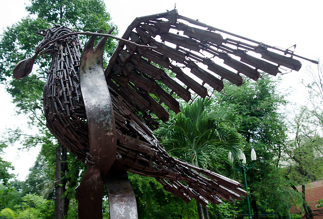 Dove peace sculpture made from old armaments - rifles, guns