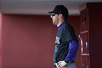Holy Cross Crusaders interim head coach Ed Kahovec watches from the dugout during the game against the South Carolina Gamecocks at Founders Park on February 15, 2020 in Columbia, South Carolina. The Gamecocks defeated the Crusaders 9-4.  (Brian Westerholt/Four Seam Images)