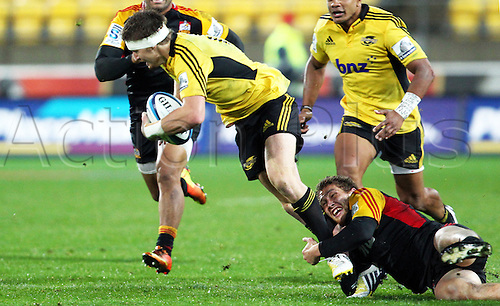 17.03.2013 Wellington, New Zealand. Chiefs' Tawera Kerr-Barlow makes the tackle on Hurricanes' Beauden Barrett during the 2013 Super Rugby season - Hurricanes v Chiefs, Westpac Stadium...