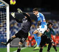 1st December 2019; Stadio San Paolo, Naples, Campania, Italy; Serie A Football, Napoli versus Bologna; Giovanni Di Lorenzo of Napoli challenges goalkeeper Lukasz Skorupski of Bologna for the crossed ball - Editorial Use