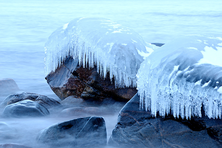 Large rocks along the Lake Superior shoreline coated in a thick layer of ice. Marquette, MI
