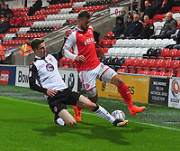 Fleetwood Town's Baily Cargill battles with Morecambe's Reece Deakin<br /> <br /> Photographer Dave Howarth/CameraSport<br /> <br /> EFL Checkatrade Trophy - Northern Section Group A - Fleetwood Town v Morecambe - Tuesday 3rd October 2017 - Highbury Stadium - Fleetwood<br />  <br /> World Copyright &copy; 2018 CameraSport. All rights reserved. 43 Linden Ave. Countesthorpe. Leicester. England. LE8 5PG - Tel: +44 (0) 116 277 4147 - admin@camerasport.com - www.camerasport.com