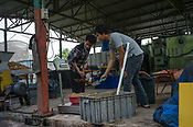 Workers weigh the food for maggots at the pilot project farm involving maggot production in village Kundang, at the outskirts of capital Kuala Lumpur, Malaysia.