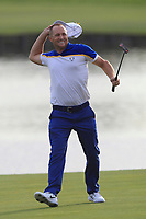 Alex Noren (Team Europe) makes his putt on the 18th green and wins his match during the Sunday Singles of the Ryder Cup, Le Golf National, Ile-de-France, France. 30/09/2018.<br /> Picture Thos Caffrey / Golffile.ie<br /> <br /> All photo usage must carry mandatory copyright credit (© Golffile | Thos Caffrey)