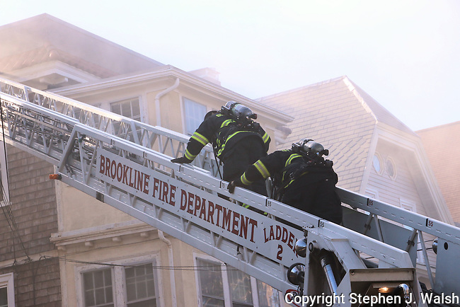 2 alarm fire in a 3 story wood frame. One female victim rescued by Ladder 2.