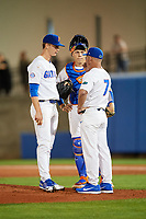 Florida Gators head coach Kevin O'Sullivan (7) talks with starting pitcher Brady Singer (51) and catcher JJ Schwarz (22) during a game against the Siena Saints on February 16, 2018 at Alfred A. McKethan Stadium in Gainesville, Florida.  Florida defeated Siena 7-1.  (Mike Janes/Four Seam Images)