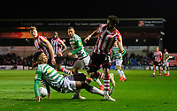 Lincoln City's Bruno Andrade is fouled by Yeovil Town's Rhys Browne<br /> <br /> Photographer Chris Vaughan/CameraSport<br /> <br /> The EFL Sky Bet League Two - Lincoln City v Yeovil Town - Friday 8th March 2019 - Sincil Bank - Lincoln<br /> <br /> World Copyright © 2019 CameraSport. All rights reserved. 43 Linden Ave. Countesthorpe. Leicester. England. LE8 5PG - Tel: +44 (0) 116 277 4147 - admin@camerasport.com - www.camerasport.com