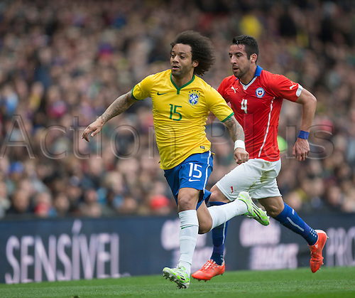29.03.2015.  London, England. International Football Friendly. Brazil versus Chile. Brazil's Marcelo and Chile's Mauricio Isla.