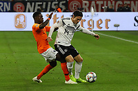 Nico Schulz (Deutschland Germany) gegen Quincy Promes(Niederlande) - 19.11.2018: Deutschland vs. Niederlande, 6. Spieltag UEFA Nations League Gruppe A, DISCLAIMER: DFB regulations prohibit any use of photographs as image sequences and/or quasi-video.
