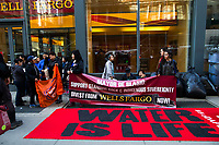 NEW YORK, NY - APRIL 5: Indigenous peoples and Activists begin the overnight camp out in front of Wells Fargo branch on April 5, 2017 in Soho, New York City. Activists are looking to drive mayor Bill De Blasio attention to divest founds from banks like Wells Fargo &amp; Company which has caused controversy for their investment in the Dakota Access Pipeline (DAPL)&mdash;a project that will be constructed through land owned by the Standing Rock Indian Reservation and covers land stretching from North Dakota to central Illinois. Photo by VIEWpress/Eduardo MunozAlvarez<br /> <br /> divest