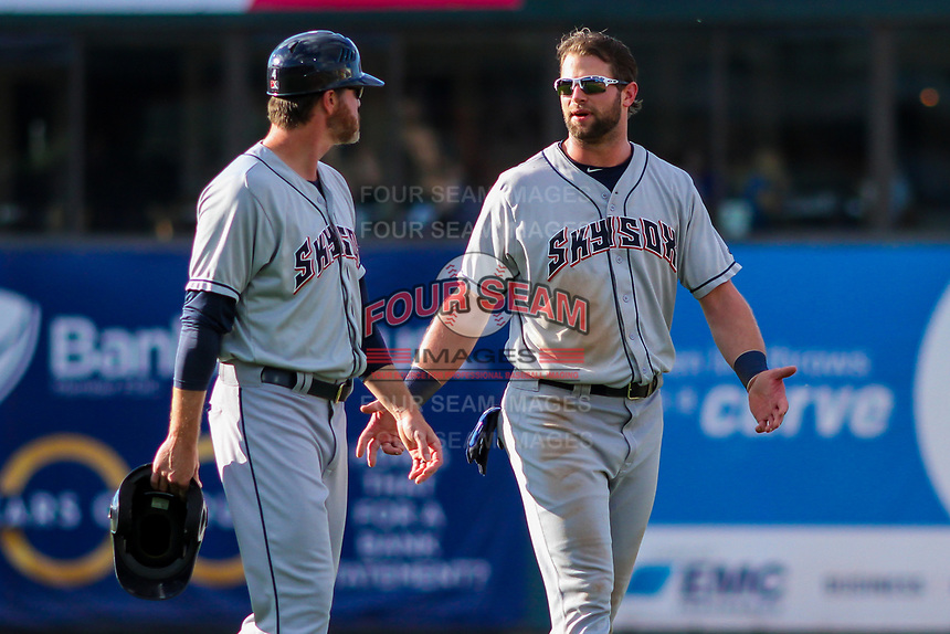 Colorado Springs Sky Sox batting coach Ned Yost IV (4) and outfielder Kirk Nieuwenhuis (33) during game one of a Pacific Coast League doubleheader against the Iowa Cubs on August 17, 2017 at Principal Park in Des Moines, Iowa. Iowa defeated Colorado Springs 1-0. (Brad Krause/Four Seam Images)