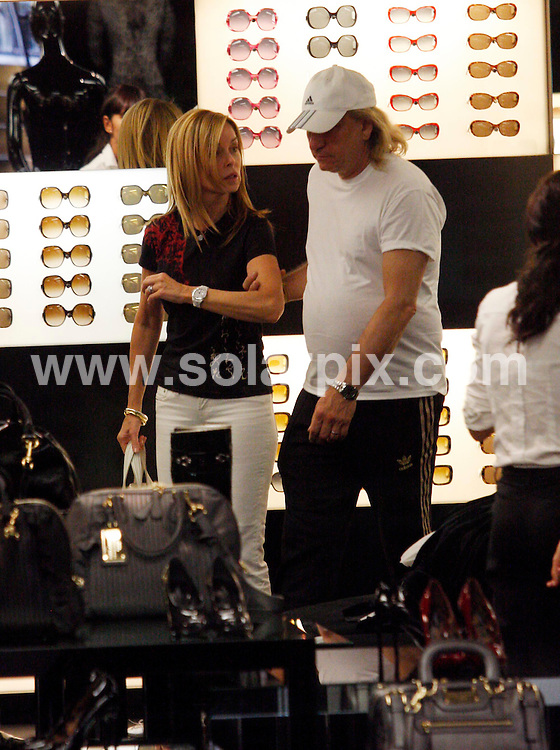 **ALL-ROUND EXCLUSIVE PICTURES FROM SOLARPIX.COM**.**UK SYNDICATION RIGHTS ONLY**.Joe Walsh, musician from the rock band 'The Eagles' seen shopping with his girlfriend in the Dolce & Gabbana shop in Madrid. 20 July 2009..This pic: Joe Walsh..JOB REF: 9540 SKX      DATE: 20_07_2009.**MUST CREDIT SOLARPIX.COM OR DOUBLE FEE WILL BE CHARGED**.**ONLINE USAGE FEE GBP 50.00 PER PICTURE - NOTIFICATION OF USAGE TO PHOTO @ SOLARPIX.COM**.**CALL SOLARPIX : +34 952 811 768 or LOW RATE FROM UK 0844 617 7637**