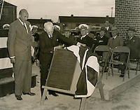 1941  October  17..Merrimack Landing   ..Scene taken during Dedication Ceremony at Merrimack Park, Norfolk, VA on 10-17-1941.  Picture shows Mayor J. D. Wood unveiling Memorial Plaque, Mr. Louis H. Windholz, Chairman NRHA, who acted as Master of Ceremonies, is shown in left foreground.  To Mr. Windholz's left are Mr. Chas L. Kaufman, Vice Chairman NRHA, Capt. McCloy, Personnel Officer, 5th Naval District, Mr. John W. Cardwell, USHA Construction Advisor, Mr. J. E. Etheridge, Commissioner NRHA, Mr. David Pender, Commissioner NRHA, and Dr. J. W. Reed, City Councilman...NEG# MDA70-86-3.445..