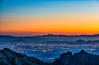This post sunset sky of the city of Tucson created this nice golden glow with the city lights lighting up the town from the mountain view above.