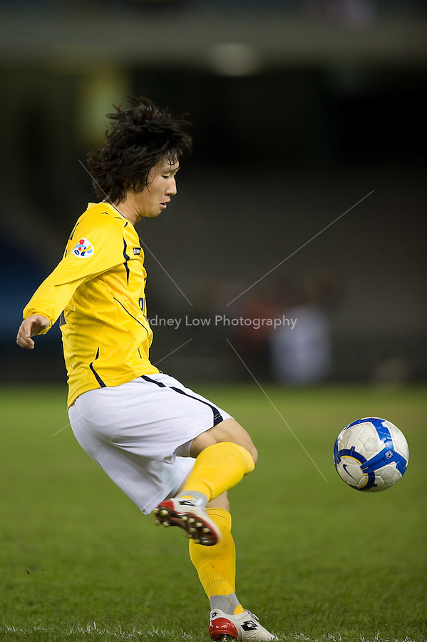 MELBOURNE, AUSTRALIA - MARCH 09, 2010: KO JAESUNG of Seongnam kicks the ball during the AFC Champions League Group E match between the Melbourne Victory and Seongnam Ilhwa Chunma at Etihad Stadium on March 9, 2010 in Melbourne, Australia. Photo Sydney Low www.syd-low.com