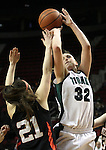 03/10/11--Tigard's Maddie Black shoots over  Oregon City's Nicole Peters  in the  quarterfinals of girls 6A championship at the Rose Garden in Portland, Or. The Pioneers advanced to the semifinals with a score of 66-36...Photo by Jaime Valdez.......................................