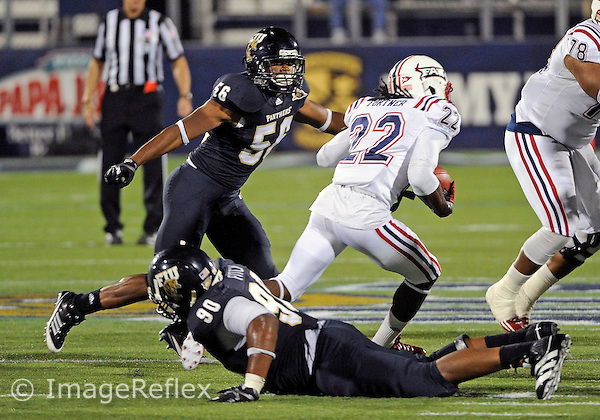 Florida International University football player linebacker Chris Edwards (56) plays against the Florida Atlantic University on November 12, 2011 at Miami, Florida. FIU won the game 41-7. .