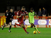 Exeter City's Ollie Watkins is tracked by Crawley Town's Joe McNerney during the Sky Bet League 2 match between Crawley Town and Exeter City at Broadfield Stadium, Crawley, England on 28 February 2017. Photo by Carlton Myrie / PRiME Media Images.