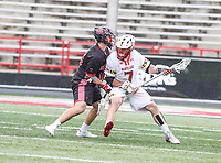 College Park, MD - April 15, 2018: Maryland Terrapins Tim Rotanz (7) holds off a Rutgers Scarlet Knights defender during game between Rutgers and Maryland at  Capital One Field at Maryland Stadium in College Park, MD.  (Photo by Elliott Brown/Media Images International)