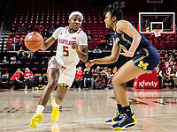 COLLEGE PARK, MD - DECEMBER 28: Kaila Charles #5 of Maryland rounds Naz Hillmon #00 of Michigan. during a game between University of Michigan and University of Maryland at Xfinity Center on December 28, 2019 in College Park, Maryland.