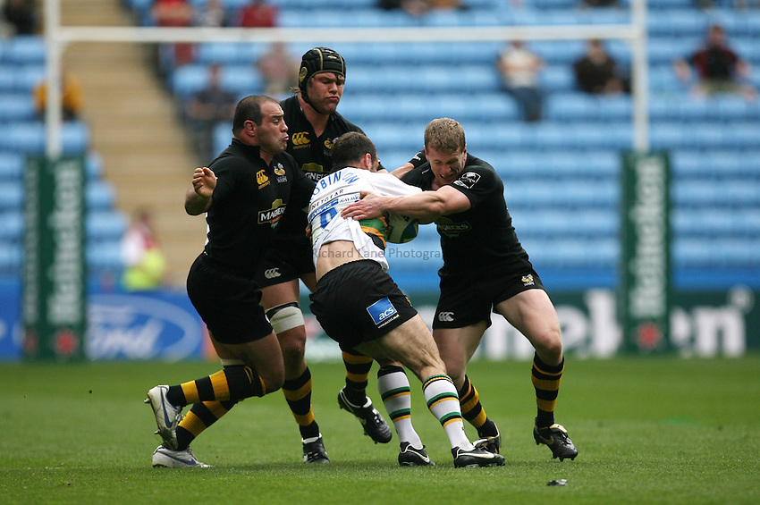 Photo: Rich Eaton...Northampton Saints v London Wasps. Heineken Cup, Semi Final. 22/04/2007. The Wasps defence stops Northamptons Mark Robinson