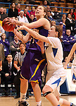 SIOUX FALLS, SD - MARCH 10:  Ashley Luke #5 from Western Illinois is fouled by Amanda Hyde #11 from IPFW during overtime of their quarterfinal game Sunday afternoon at the 2013 Summit League Championships in Sioux Falls, SD.  (Photo by Dave Eggen/Inertia)
