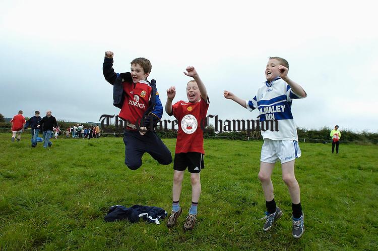 Brian Cahill, Eoin Grace and Ronan Grace cheer on their club team mates