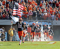 Virginia Cavalier players take the field during the game against Maryland in Charlottesville, Va. Maryland defeated Virginia 27-20.
