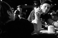 "Pat Baffa tries to take his opponent down at the 28th Annual Big Apple Grapple, held in New York City on March 19, 2005.  The tournament is the first in the 2005 New York Arm Wrestling Association's ""Golden Arm Series""."