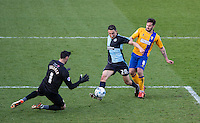 Luke O'Nien of Wycombe Wanderers beats Chris Clements of Mansfield Town but cannot beat Goalkeeper Scott Shearer of Mansfield Town during the Sky Bet League 2 match between Wycombe Wanderers and Mansfield Town at Adams Park, High Wycombe, England on 25 March 2016. Photo by Andy Rowland.