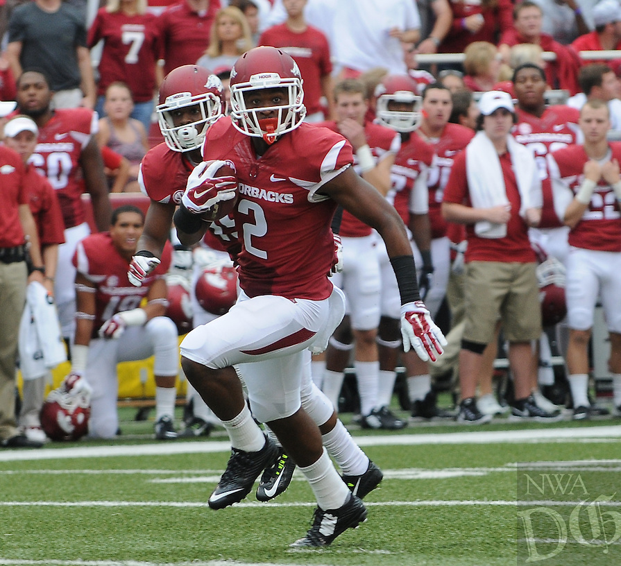 STAFF PHOTO ANTHONY REYES • @NWATONYR<br /> Arkansas' D.J. Dean checks the defense on a return against Nicholls State in the first quarter Saturday, Sept. 6, 2014 at Razorback Stadium in Fayetteville.