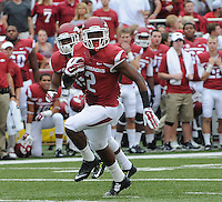 STAFF PHOTO ANTHONY REYES &bull; @NWATONYR<br /> Arkansas' D.J. Dean checks the defense on a return against Nicholls State in the first quarter Saturday, Sept. 6, 2014 at Razorback Stadium in Fayetteville.