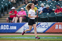 A Florida State Seminoles Bat Girl returns to the dugout after retrieving an aluminum bat during the game against the Duke Blue Devils in the first semifinal of the 2017 ACC Baseball Championship at Louisville Slugger Field on May 27, 2017 in Louisville, Kentucky.  The Seminoles defeated the Blue Devils 5-1.  (Brian Westerholt/Four Seam Images)