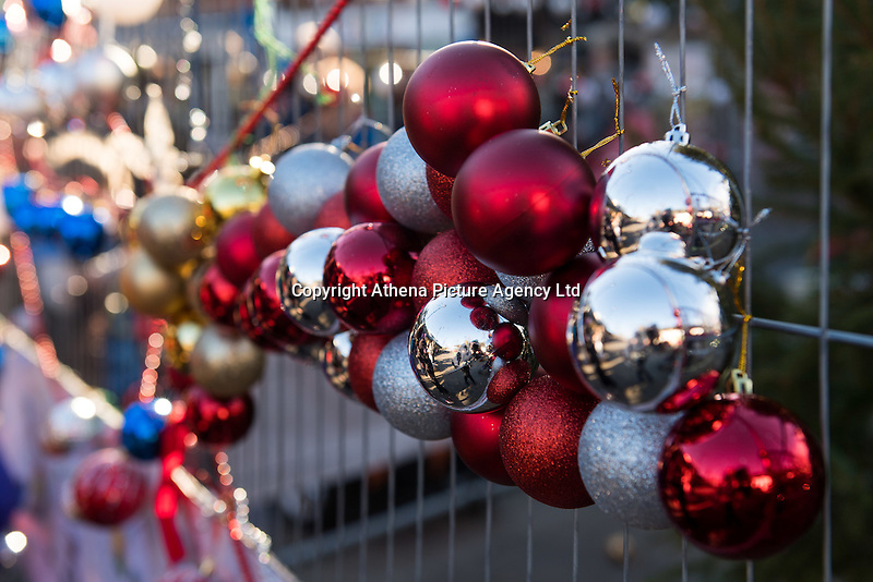 """Pictured: Decorations used for the Christmas tree in Neath, south Wales, UK. Saturday 03 December 2016<br /> Re: Residents are making their own decorations for Neath's Christmas tree this year after complaints about the town's festive decorations.<br /> Neath resident Darren Bromham-Nichols is calling on others to create their own decorations for the tree near the town centre, which has been described as """"bare with lots of dead wood."""", although the town council has said it has received no complaints.<br /> He hopes this will make Neath Town Council, who have funded the Christmas decorations for the town, take notice and help to decorate the tree."""
