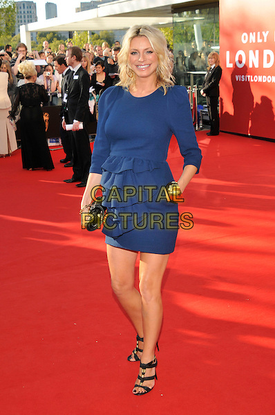 TESS DALY .Arrivals at the British Academy Television Awards 2009, Royal Festival Hall, London, England. 26th April 2009..TV Baftas bafta's full length pregnant blue ruffle front dress black clutch bag shoes sandals gold bracelet hand in pocket .CAP/PL.©Phil Loftus/Capital Pictures
