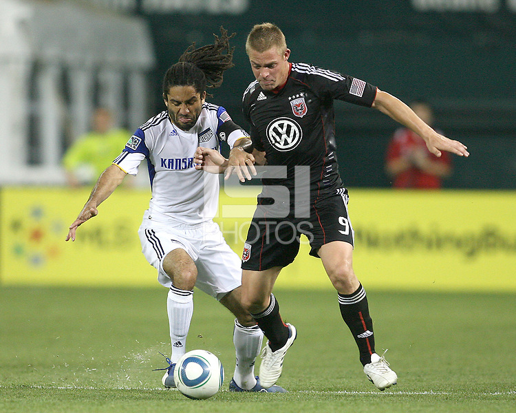 Daniel Allsopp #9 of D.C.United is tackled by Stephane Auray #8 of the Kansas City Wizards during an MLS match at RFK Stadium on May 5 2010, in Washington DC. United won 2-1
